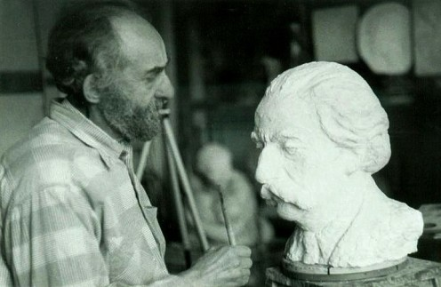 Lev is working on the bust of Yuri Lotman in his working room
