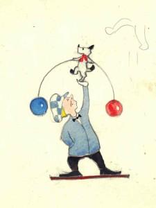 Клоун держит кота-акробата на вытянутой вверх руке